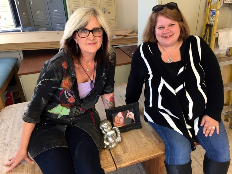 Kriss Blevens, left, and Holly Cekala in the space that will be Amber's Place, a stabilization center for those ready to change their lives. At the center of this dream is Blevens' step-daughter, Amber, who died of heroin, pictured center.