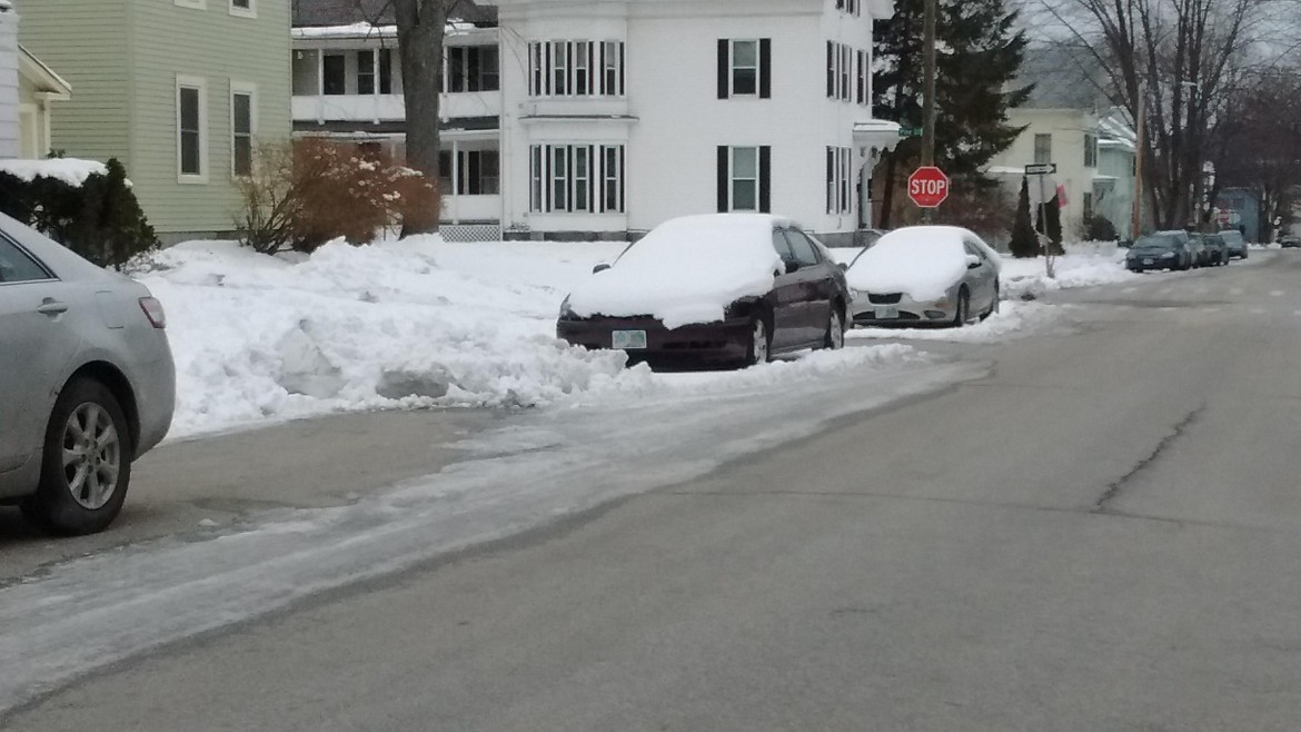 Cars at the intersection of Pine and Blodgett, obviously not towed during last weekend's citywide snow emergency.