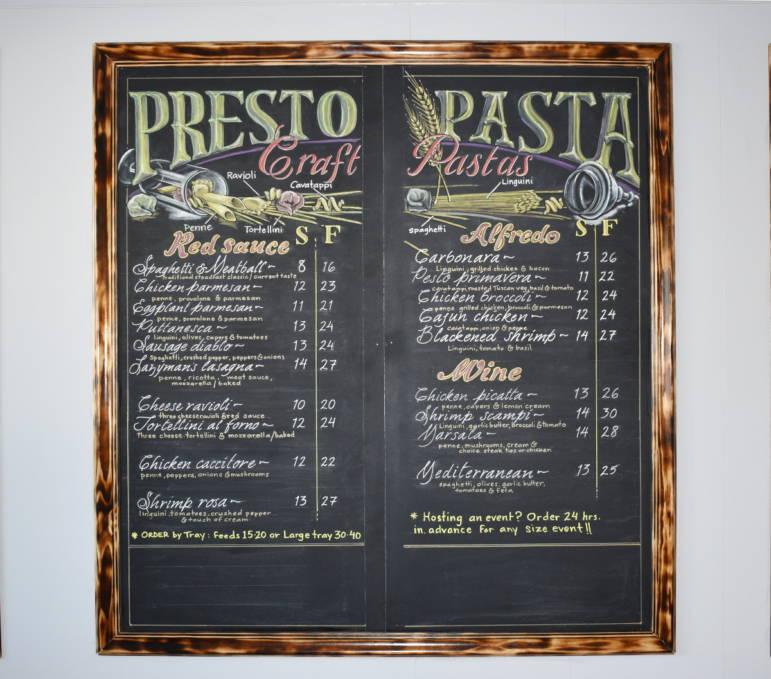 Hand lettered menu board at Presto Pasta