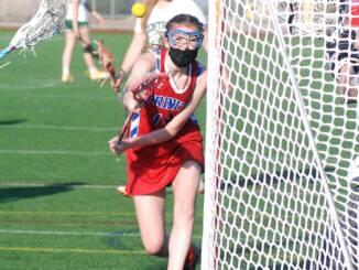 Carolyn Burleigh fires a hard shot on net.